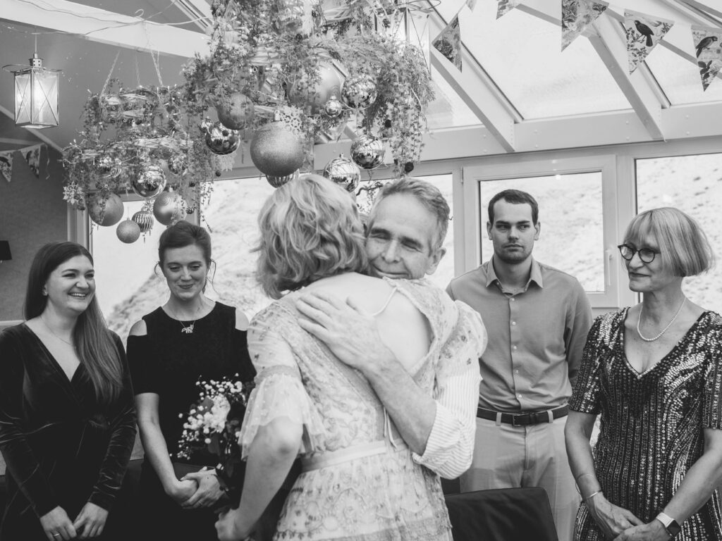 black and white photo of the bride hugging her dad