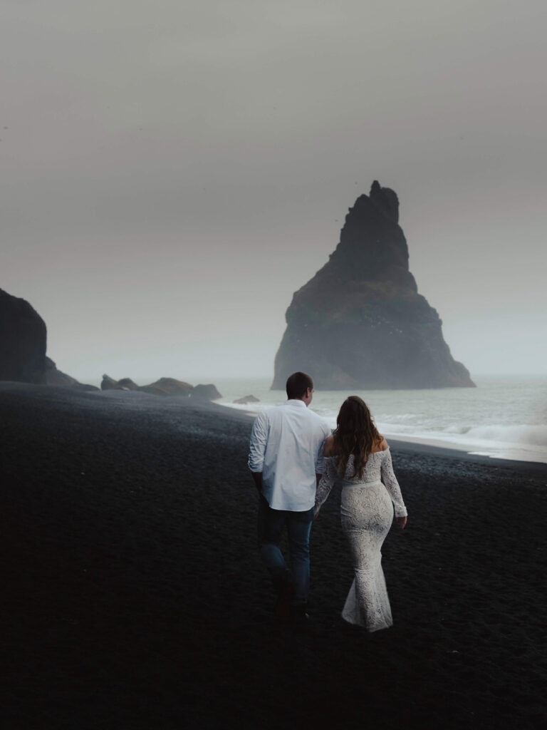 Just married walking along the beach