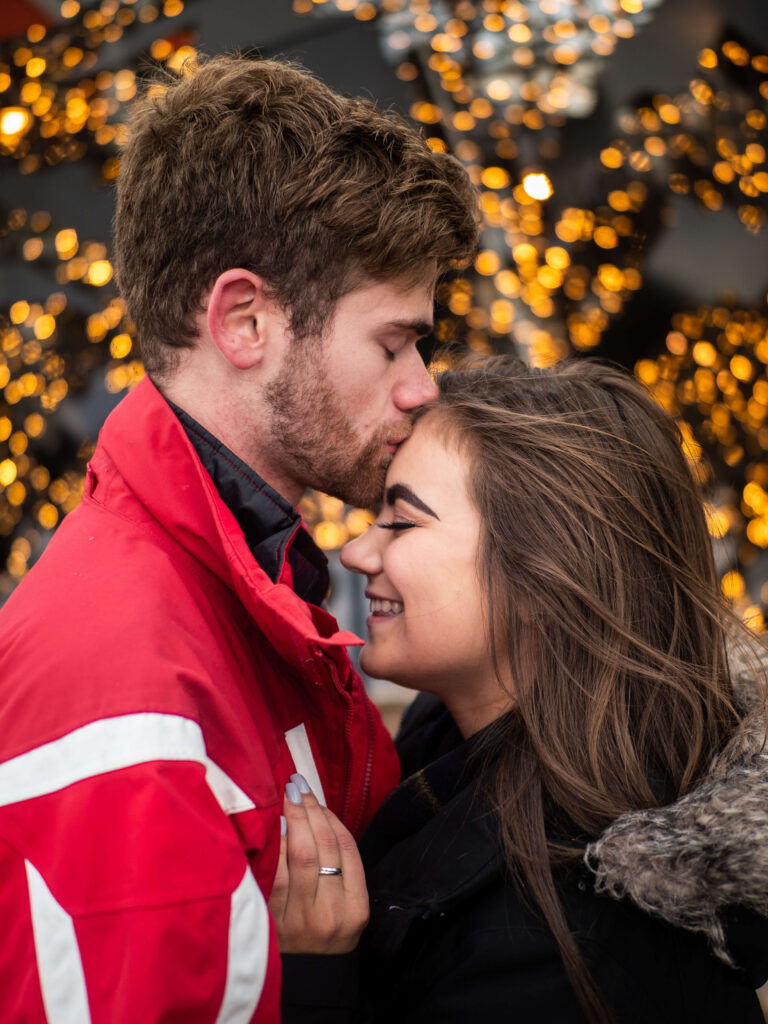couple portrait with christmas lights