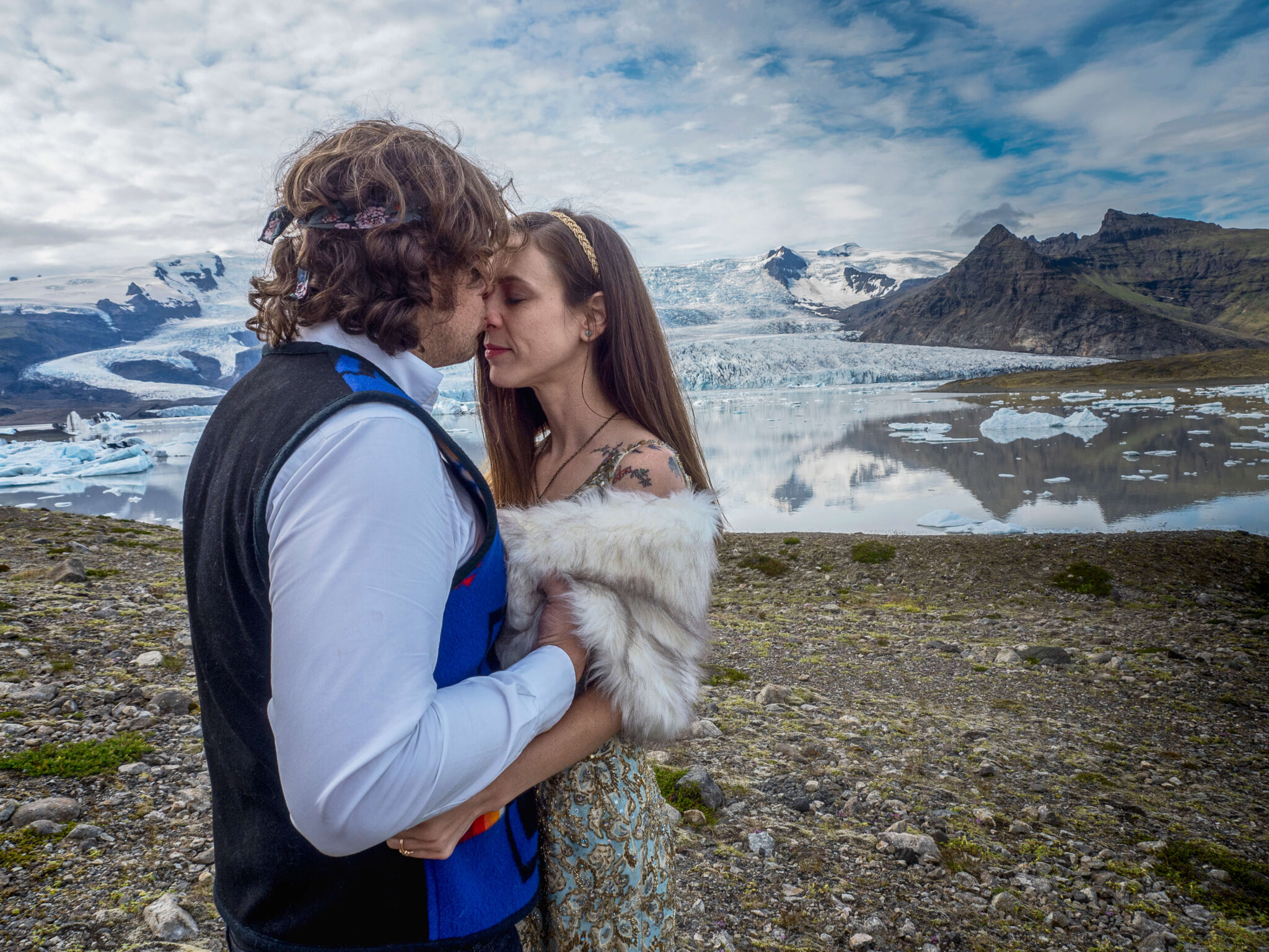 bride and groom in front of the glacier