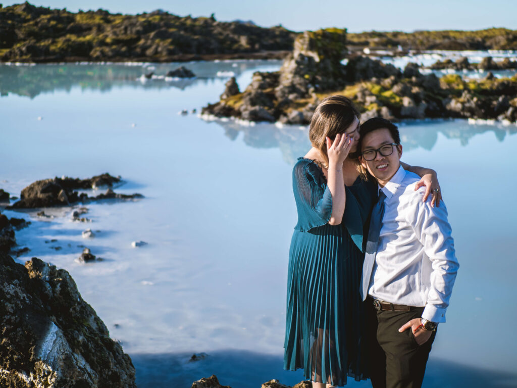 asian couple in blue lagoon on their anniversary