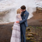 bride na groom kissing in front of the natural steam in Iceland