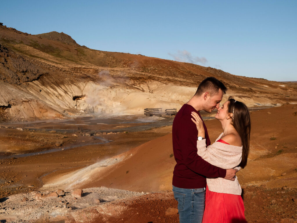 couple looking at each other in geothermal are in Iceland