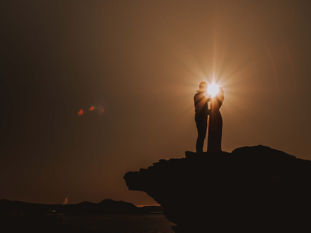 Sunset silouette engagement photo by photographer iceland