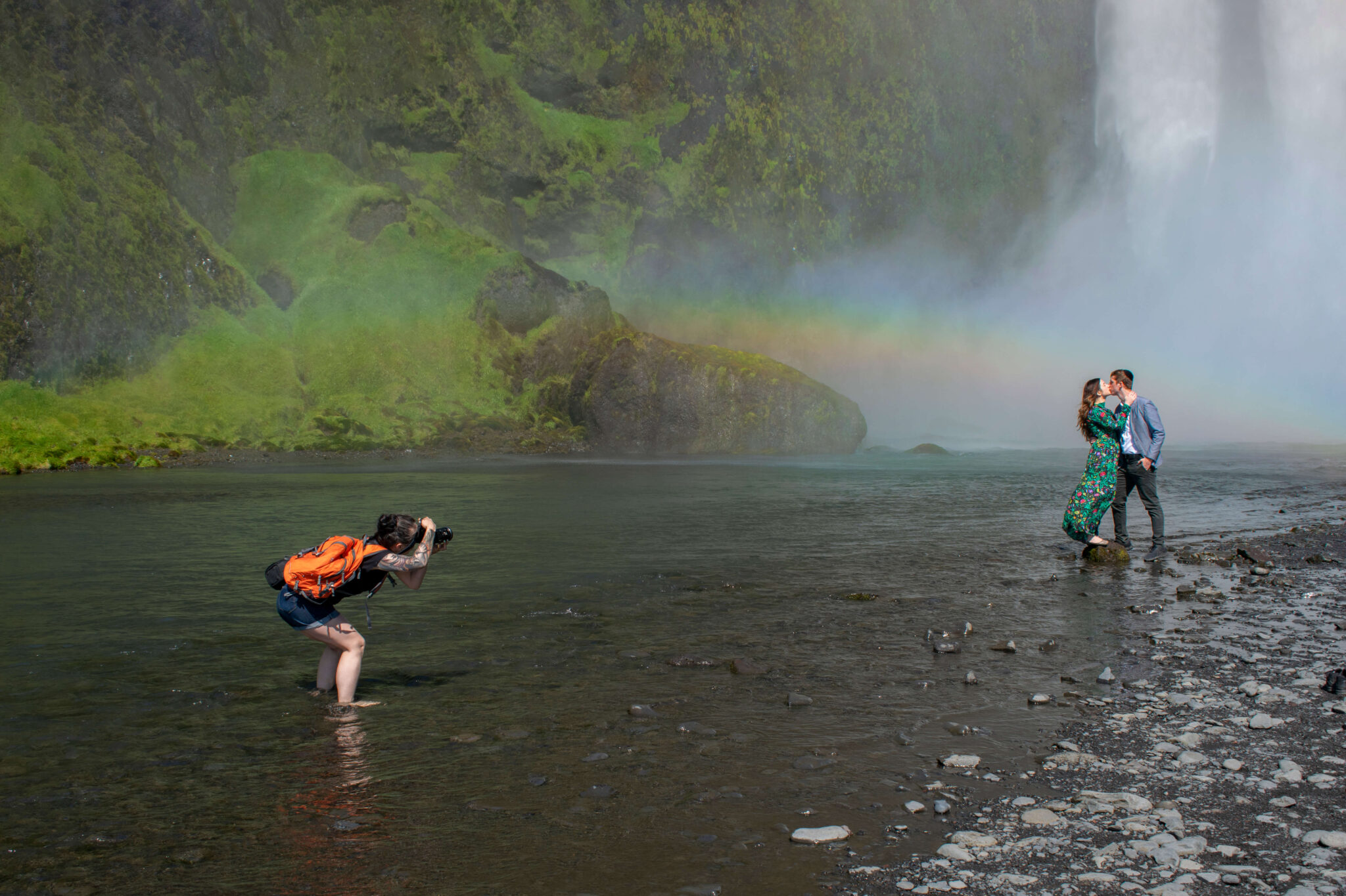 Local wedding photographer in Ieland Kat Deptula is making photo of the couple in front of the waterfall