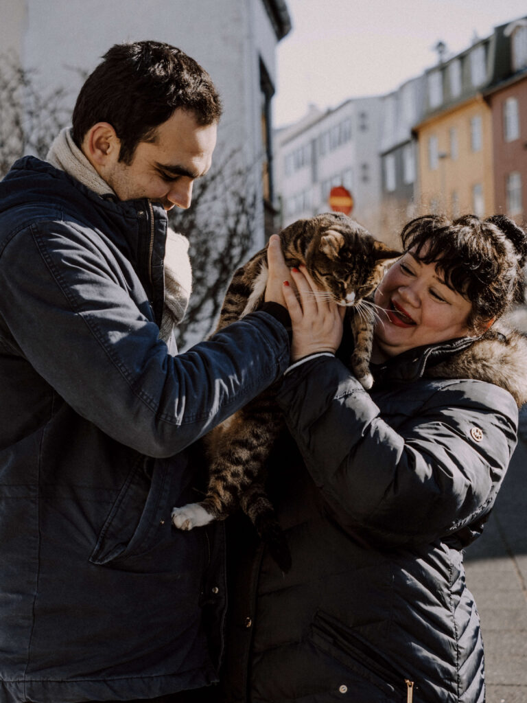 couple petting the cat n the street