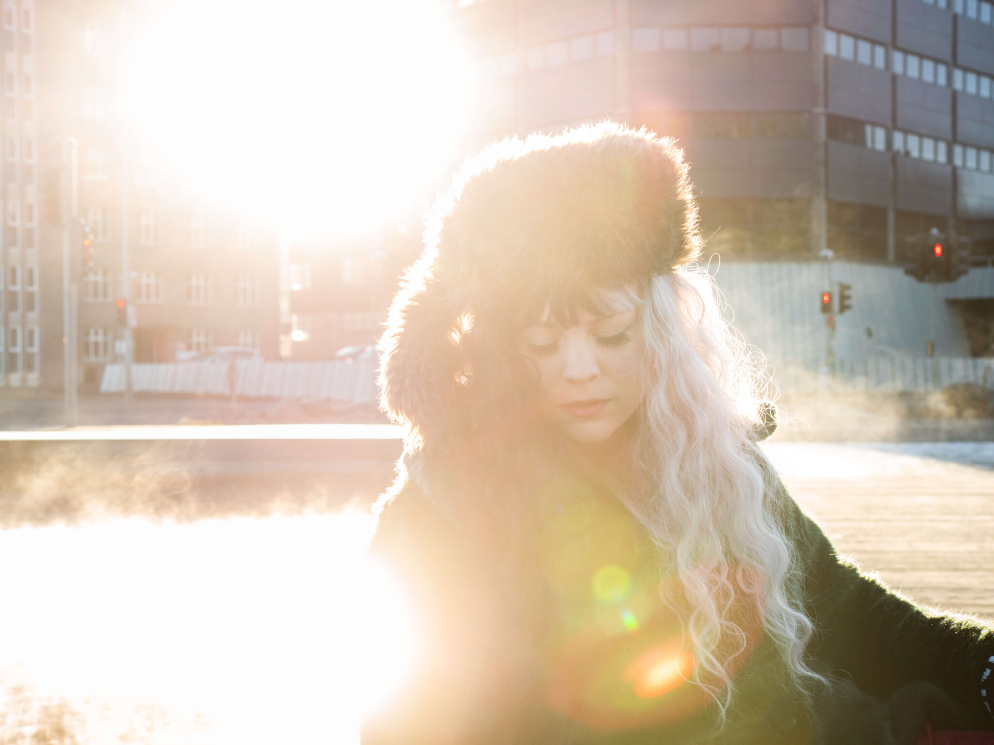 girl in a hat with beautiful light